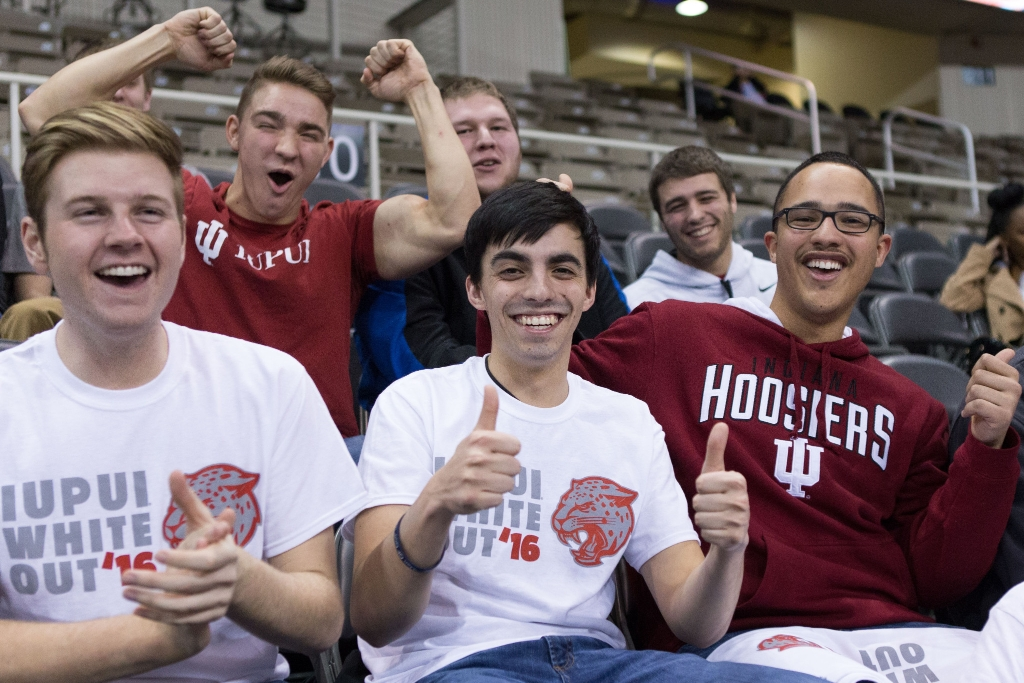 Students cheering on the Jags to victory at a men's basketball game.