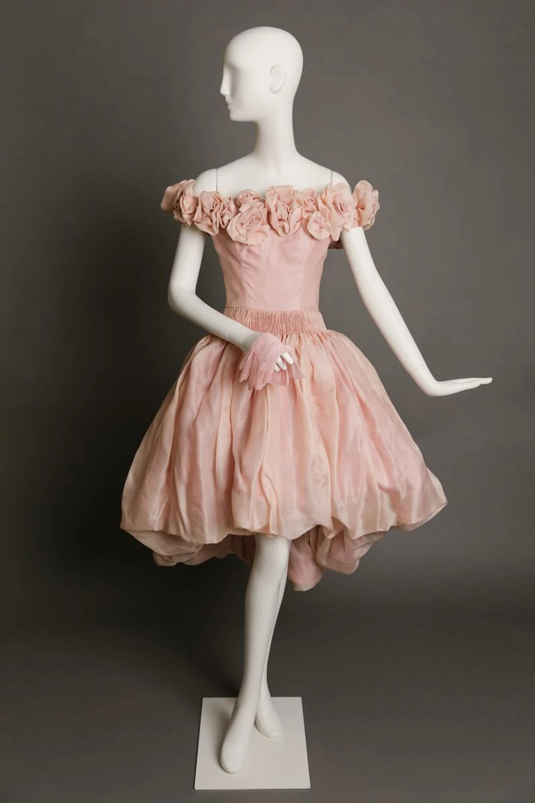 Pink silk organza cocktail dress on a mannequin