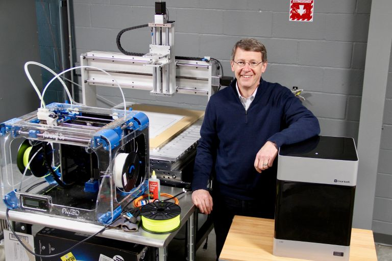 Lou Lenzi poses with machines.