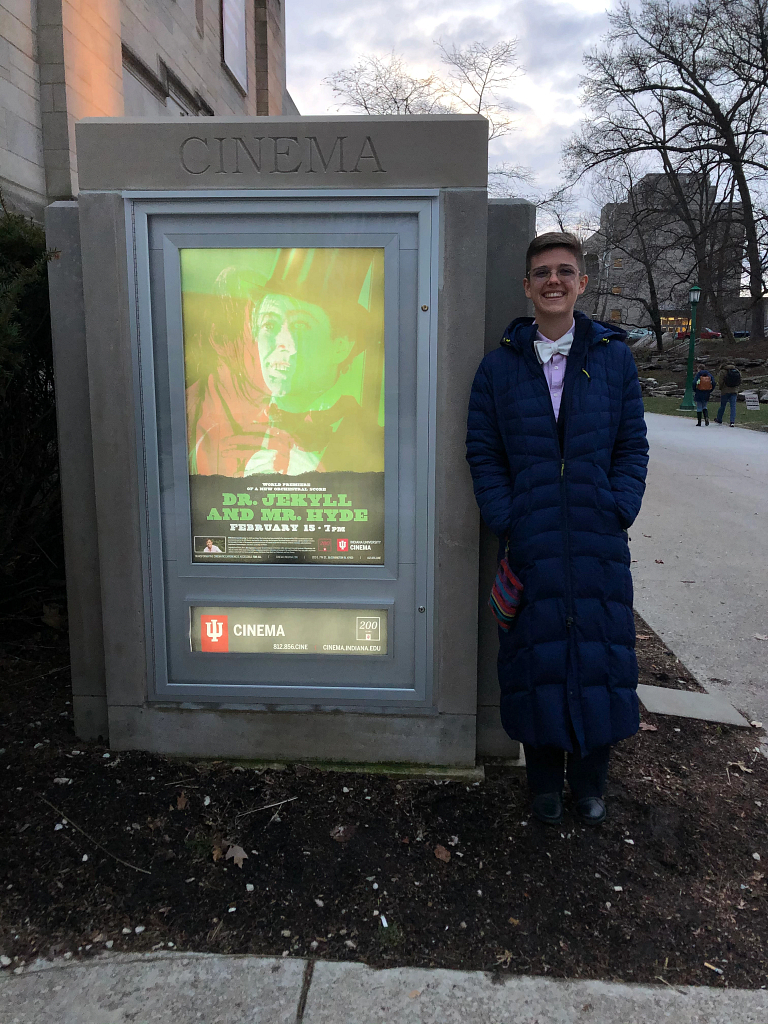 Ryn Jorgensen stands next to a 'Dr. Jekyll and Mr. Hyde' movie poster outside IU Cinema