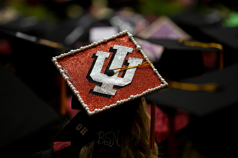 A commencement cap decorated with an glittery red IU trident