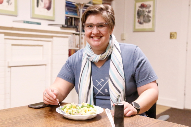 A picture of Calla Norman, president of FED at IU, holding a plate of food