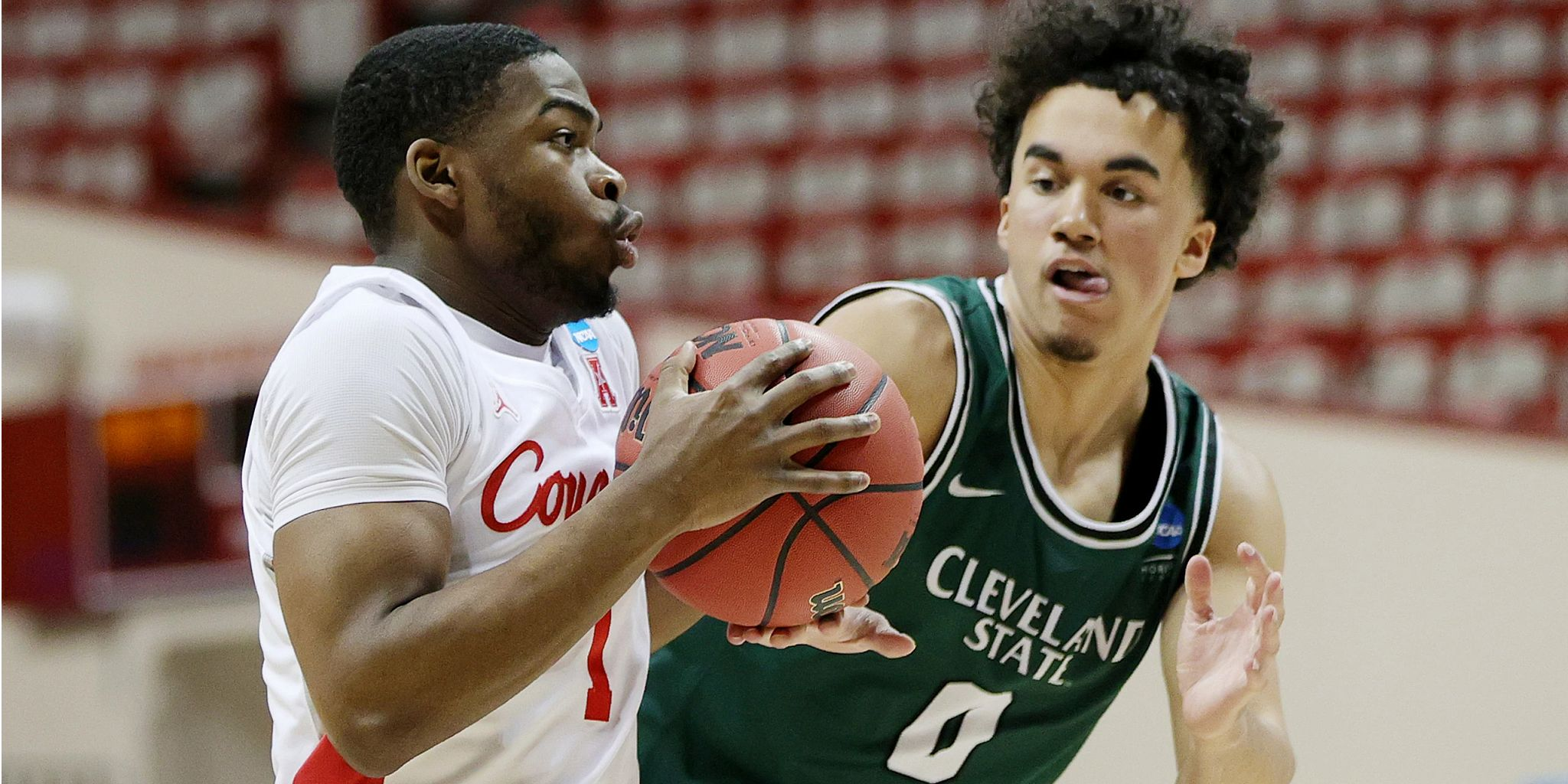 A Cleveland State player defends against a Houston player