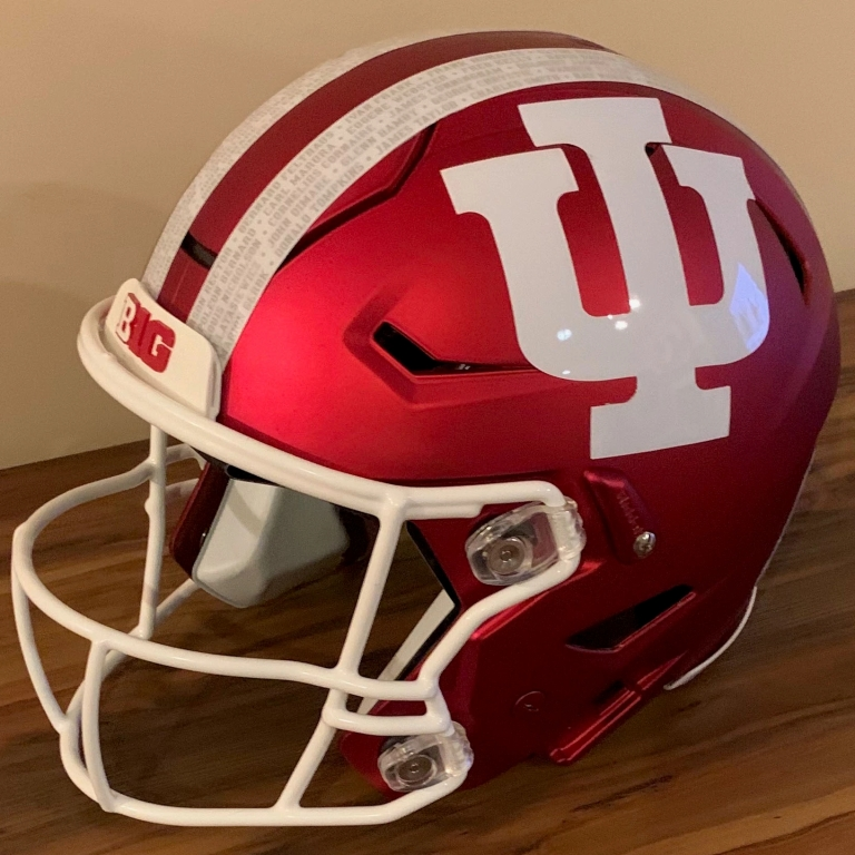 A red and white football helmet with the IU logo on the side