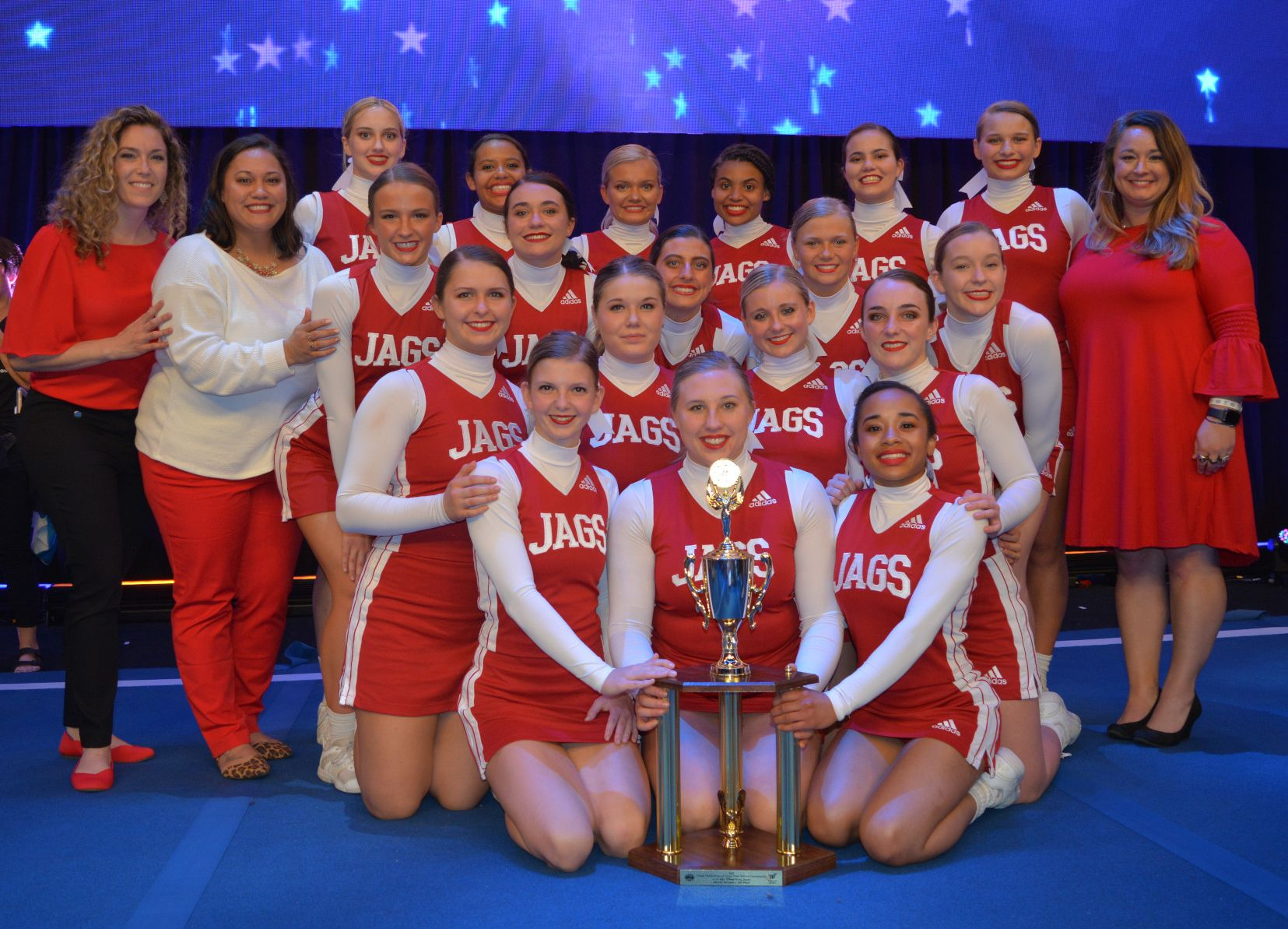 The IUPUI cheer team poses with their trophy.