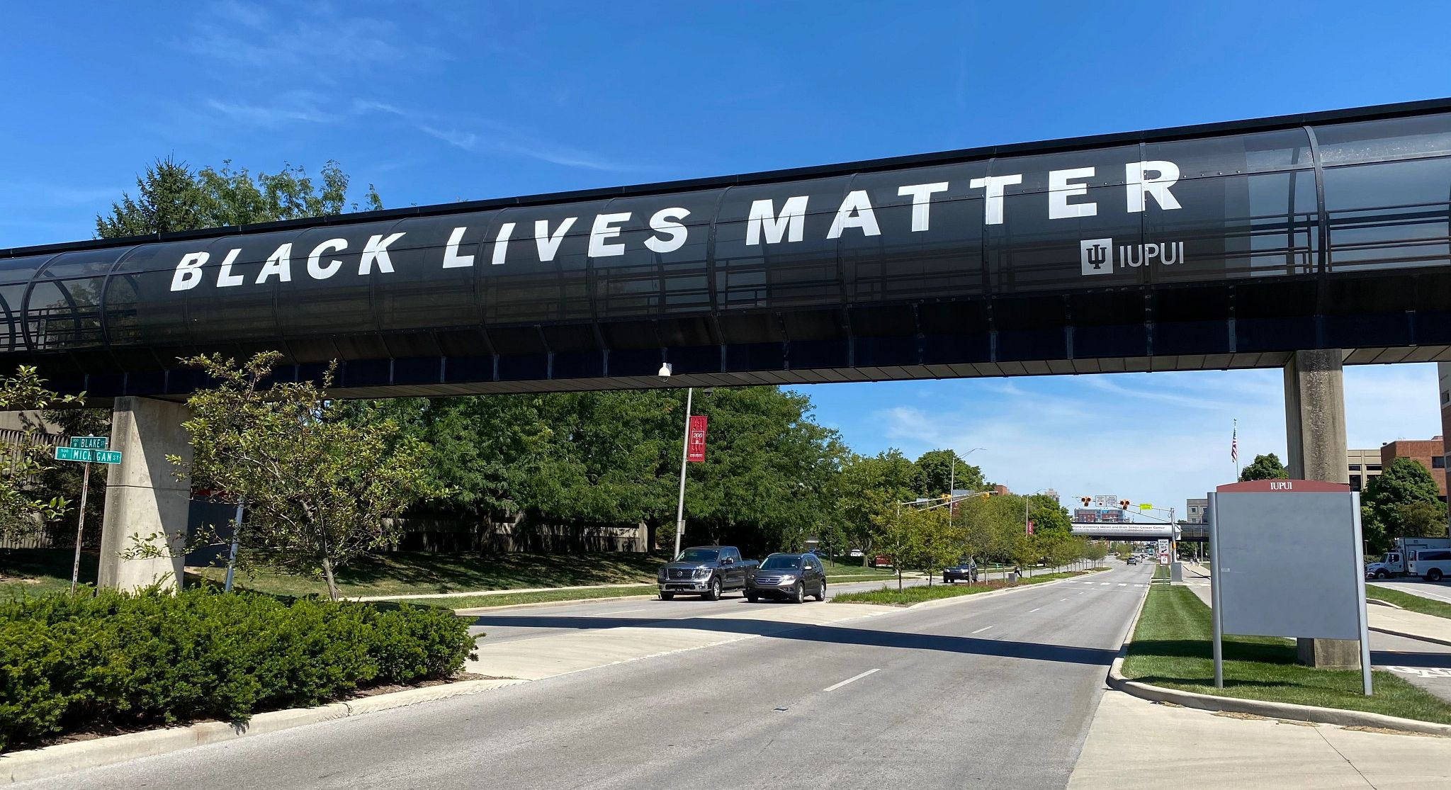 a banner on an over-the-street campus walkway reads Black Lives Matter