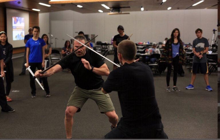 Patrick Kelly practicing a fight with martial arts student