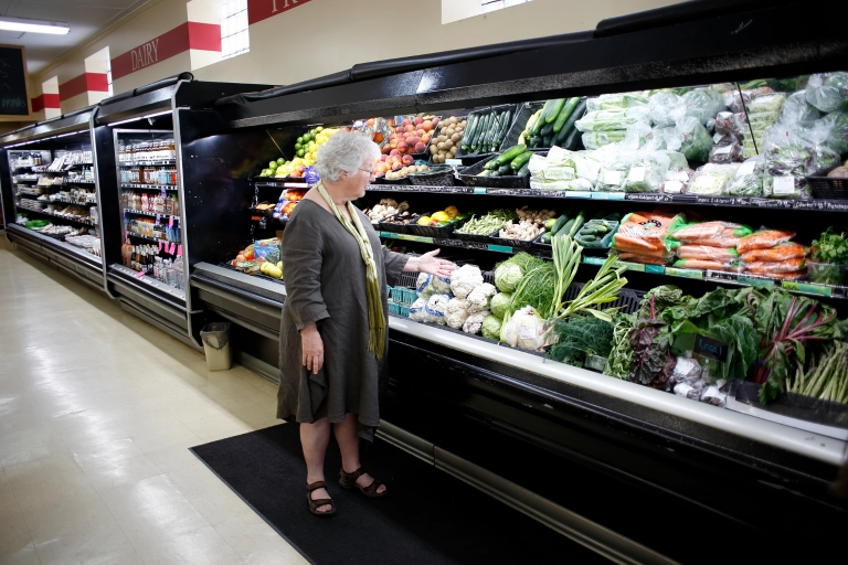 A woman shops at the Lost River Market in Paoli, Indiana