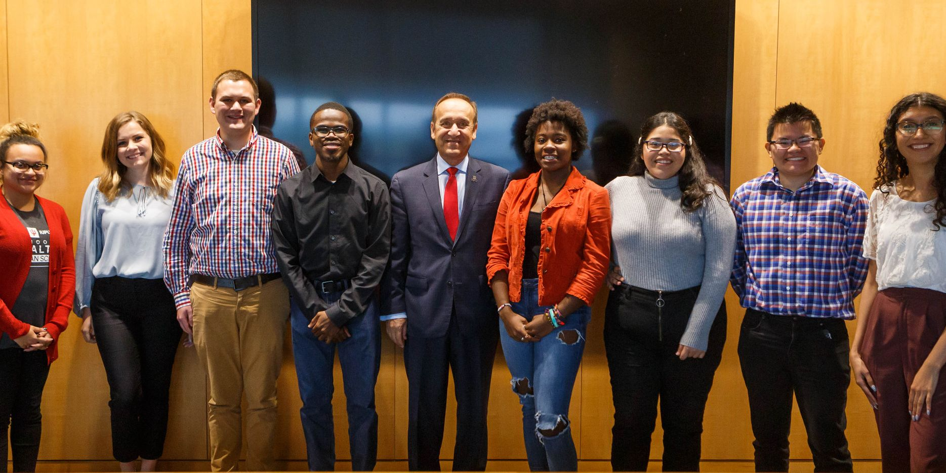 Members of the Chancellor's Student Advisory Board pose and smile with Chancellor Paydar.