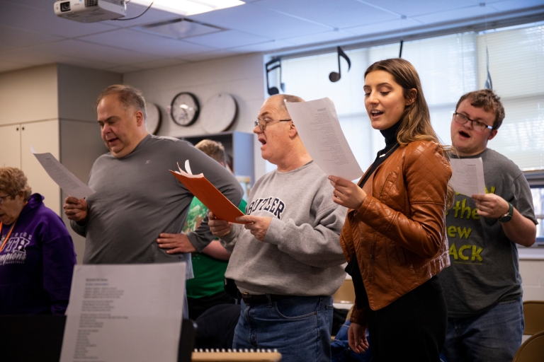 People sing in a choir rehearsal