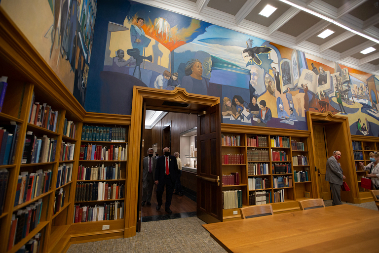 Colorful murals line the upper walls of the Lilly Library Reading Room