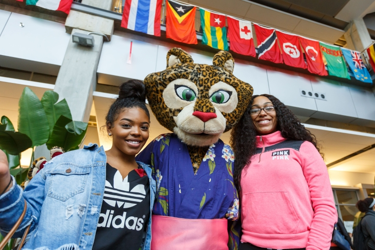 Jazzy the jaguar mascot poses at IUPUI's International Festival with students