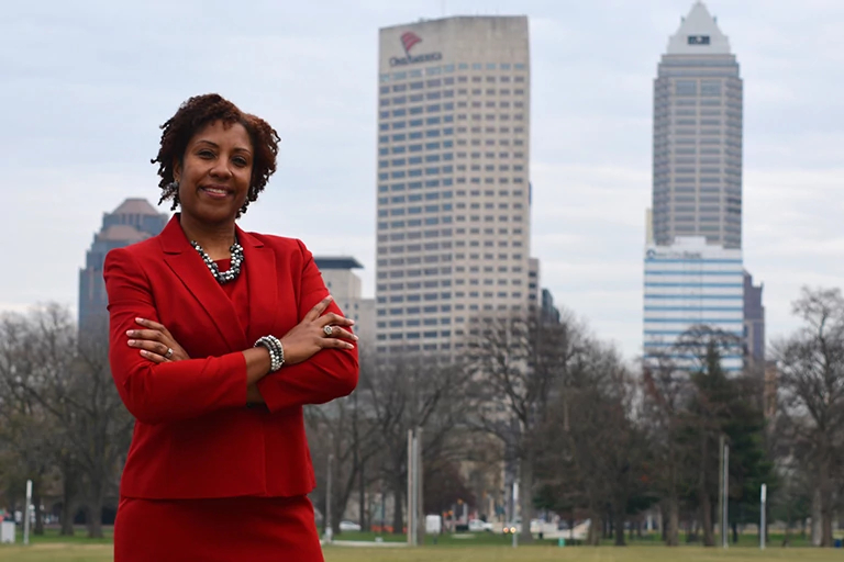 Jaunelle White of IUPUI Athletics in front of the Indianapolis skyline