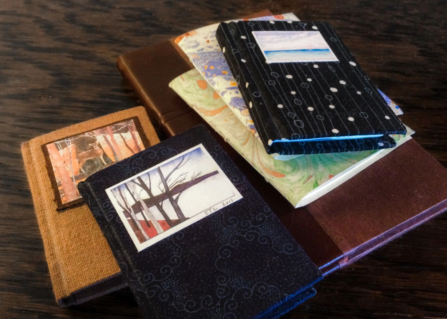 Handmade journals are pictured on a table