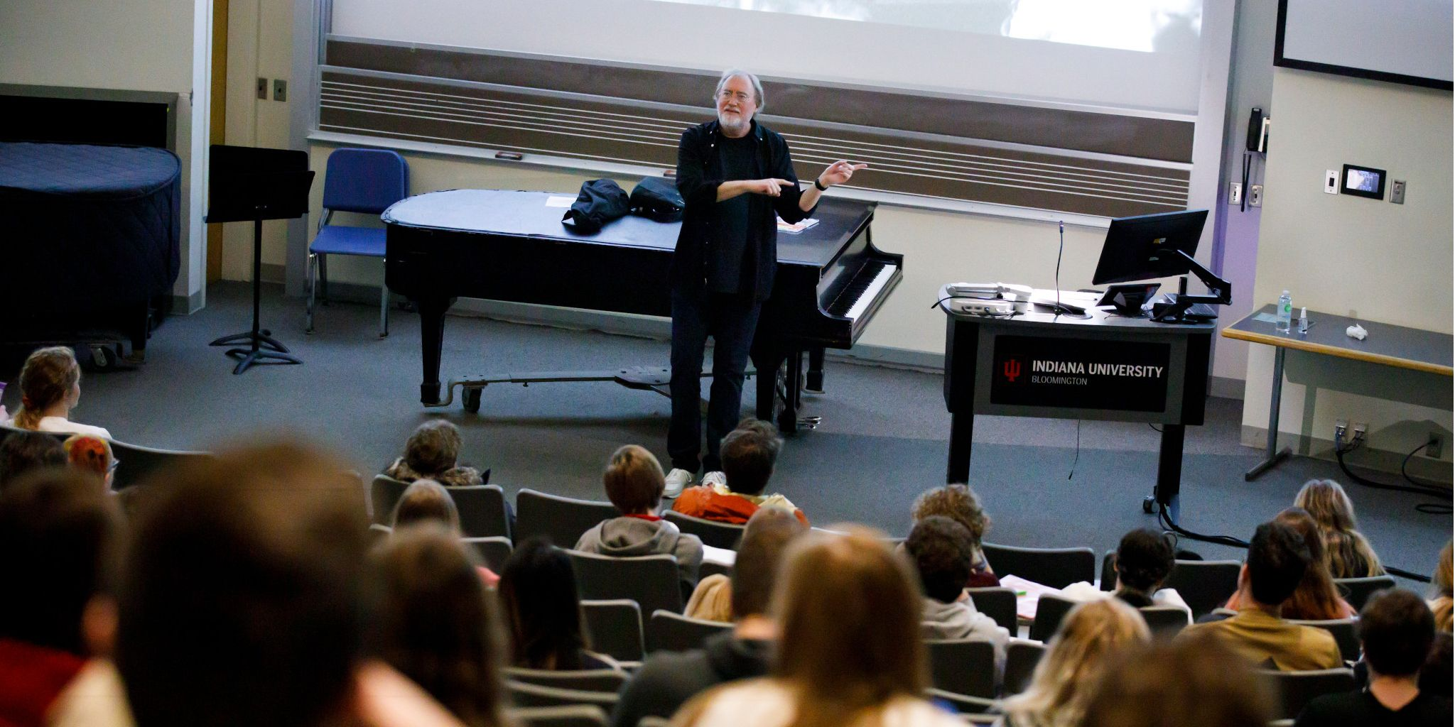 Glenn Gass teaches at the front of a lecture hall