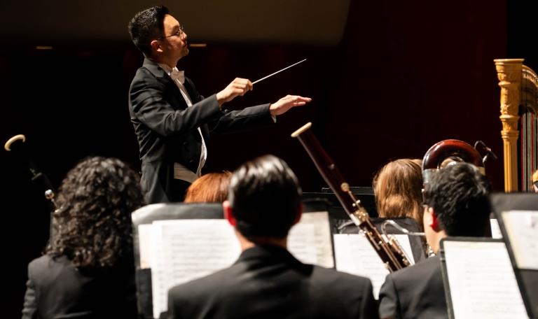 Jason Nam conducting a band