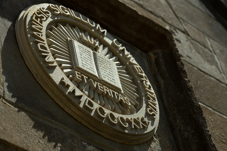 The IU seal on a building