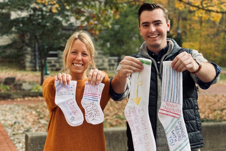 Students hold socks
