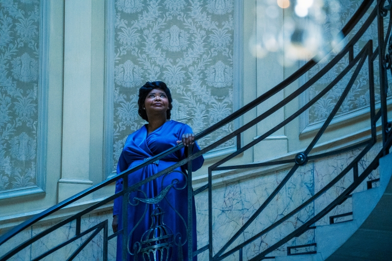 Octavia Spencer stands on a large winding staircase as Madam C.J. Walker