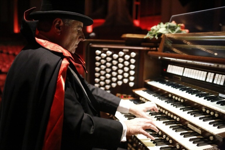 Dennis James wears a costume while playing the pipe organ