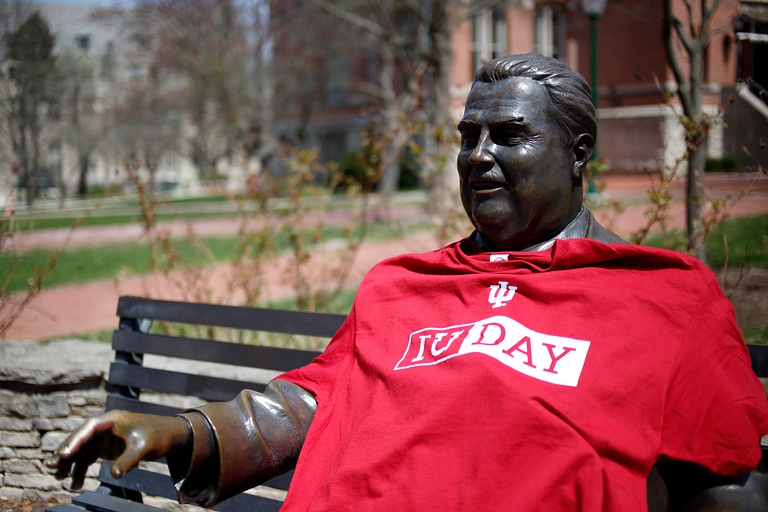 The Herman B Wells statue wearing an IU Day shirt