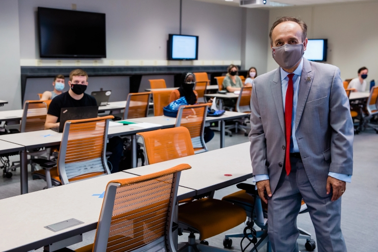 Chancellor Paydar standing in a classroom while wearing a mask