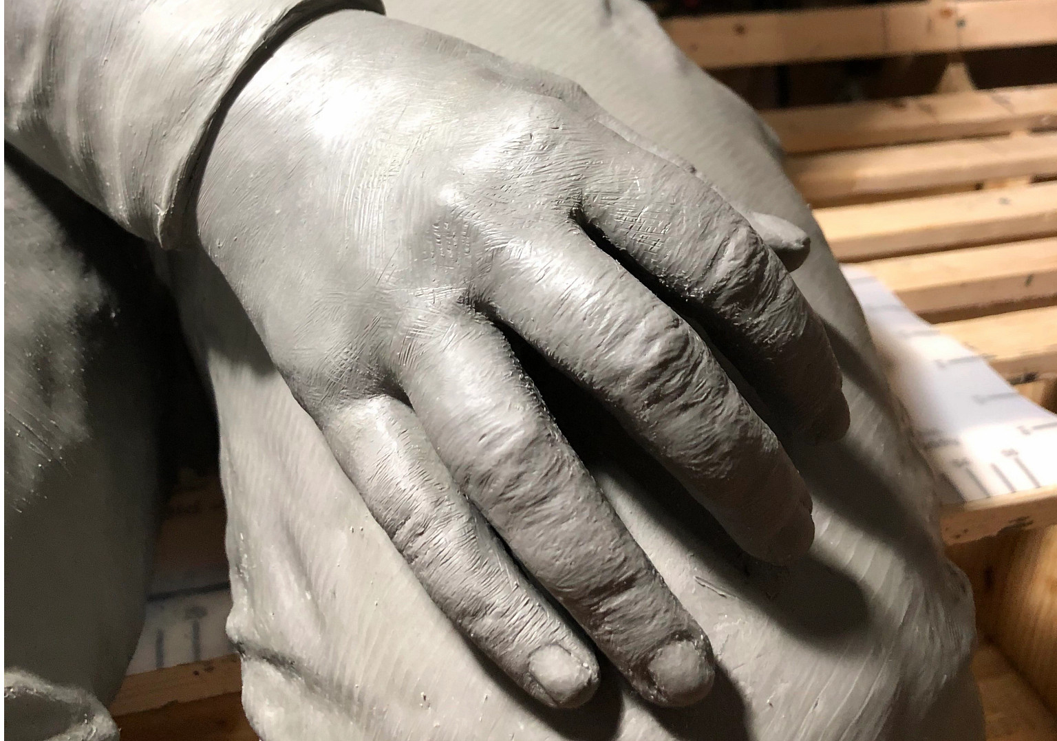 A hand sculpted from clay