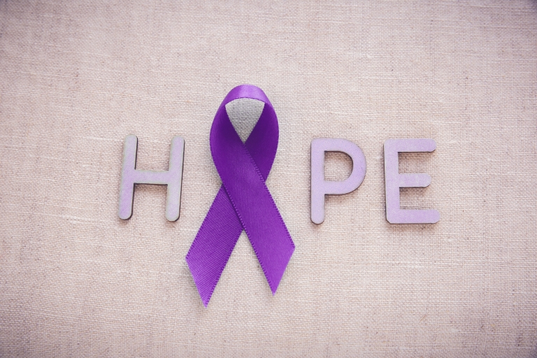 The word 'HOPE' is spelled out in purple, with a purple awareness ribbon in place of the letter 'O.'