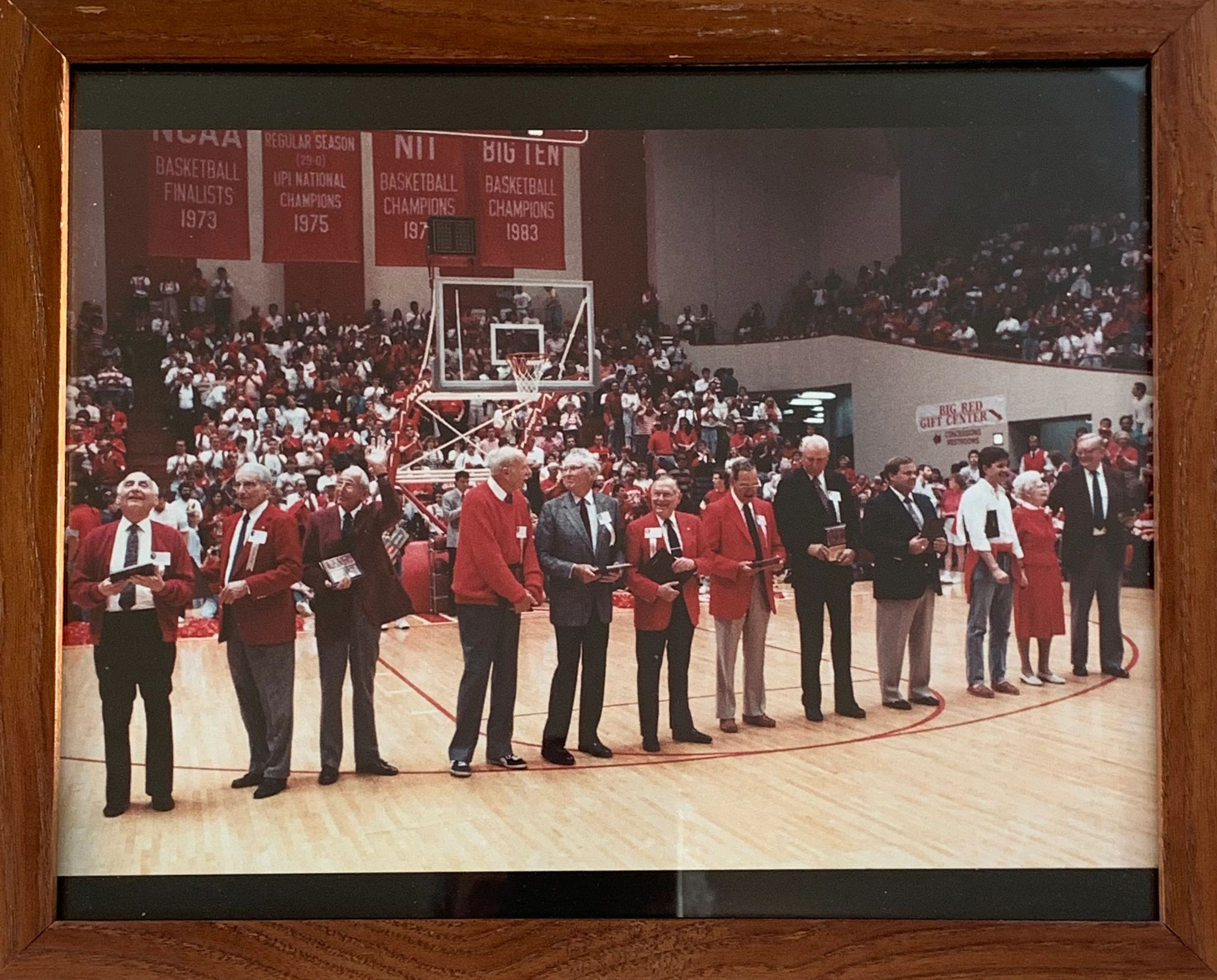 Members of the 1940 Hoosiers championship team on the floor at Assembly Hall in the late 1980s