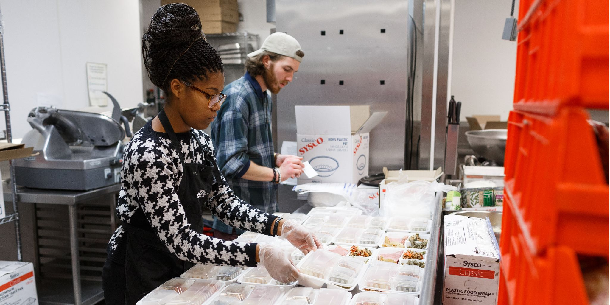 Dylan Patterson and Kaneyia Houston prepare meals for Paws' Express