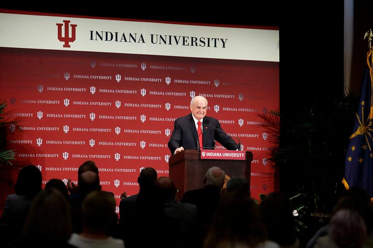 IU President McRobbie at a podium