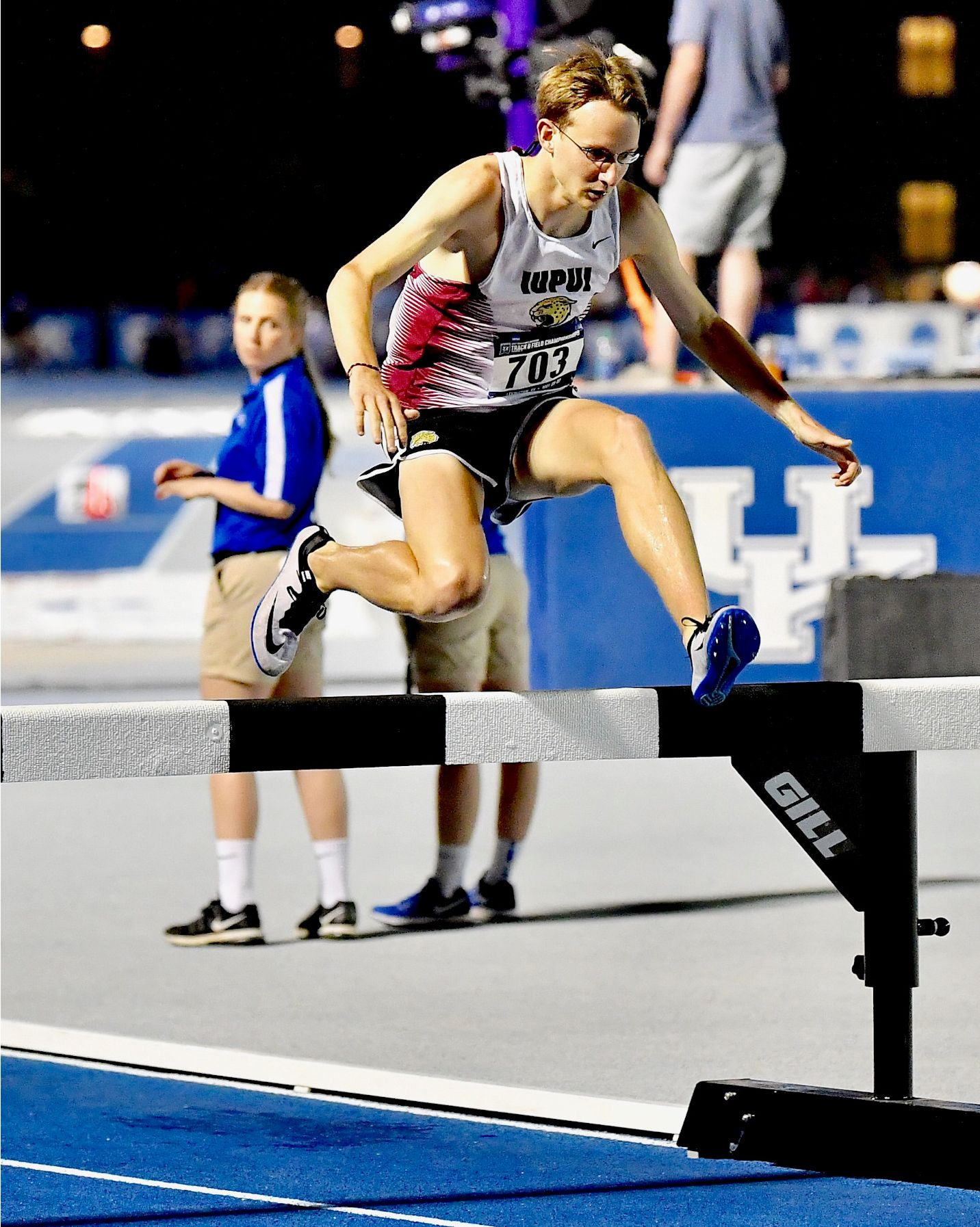 IUPUI runner Robert Murphy jumps over a barrier in the steeplechase.