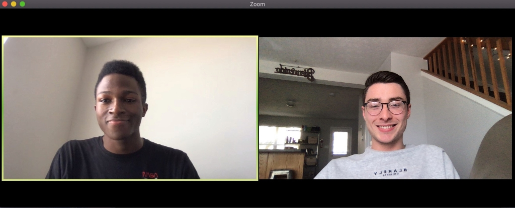 Elijah Walker and Evan Catron talk remotely through a video chat.
