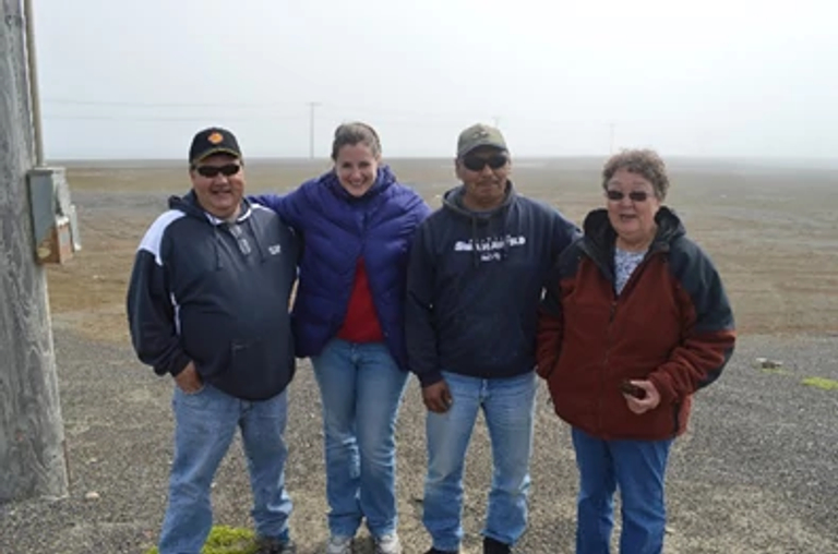 Jayne-Leigh Thomas poses with tribal leaders outside in Alaska