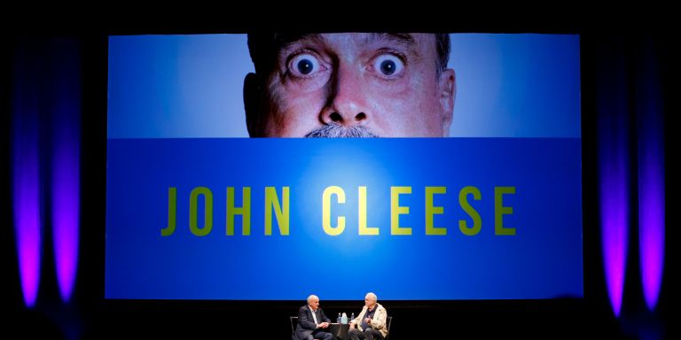 IU President McRobbie talks with comedian John Cleese on stage