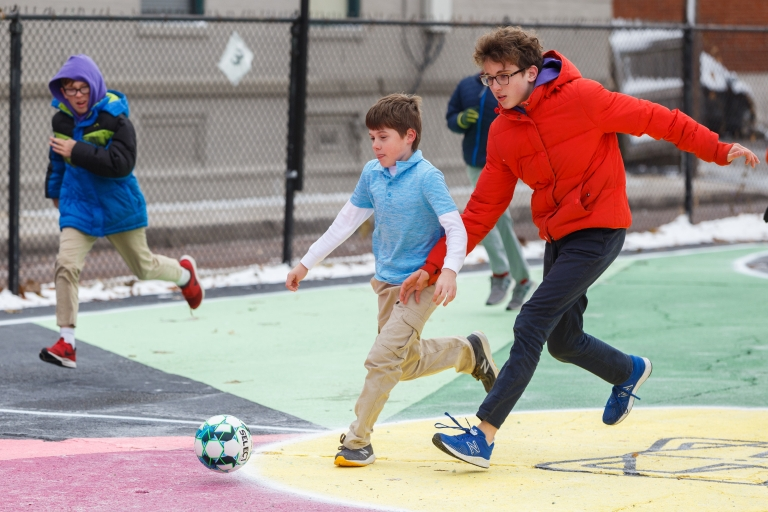 Grade school students playing on the futsal court