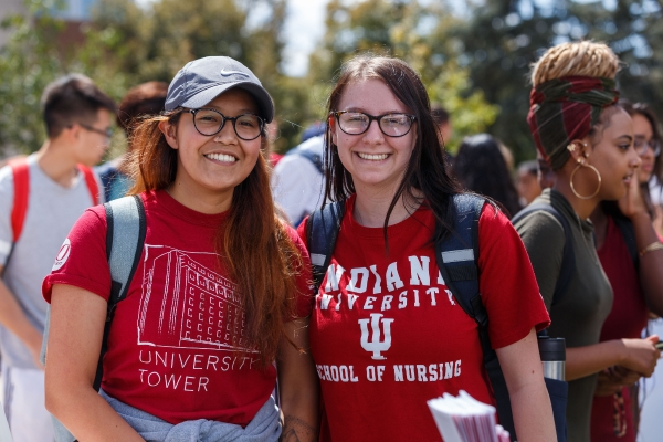 Two students pose and smile for a photo during the involvement fair.