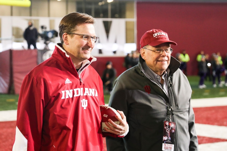 Dave O'Guinn and Larry McDaniel at an IU football game