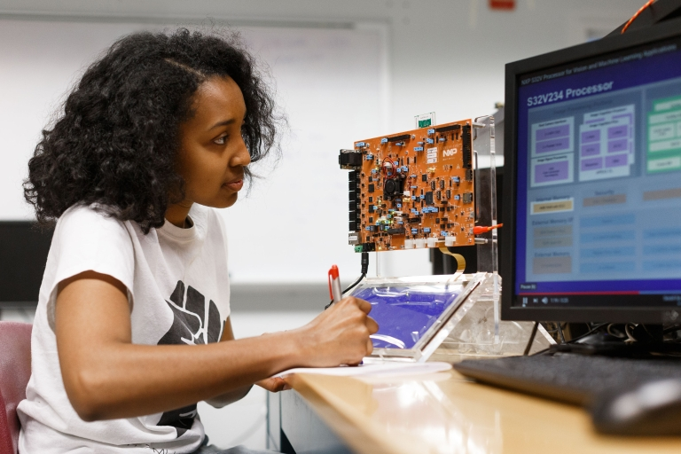 student in an engineering and computer lab