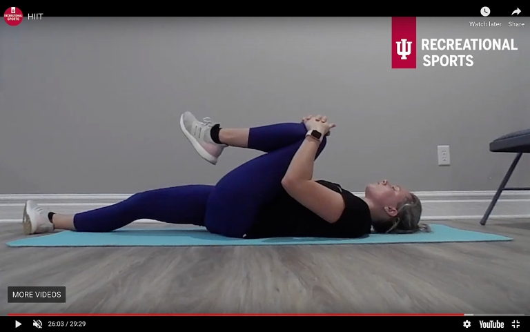 A personal trainer leads a high-intensity interval-training workout
