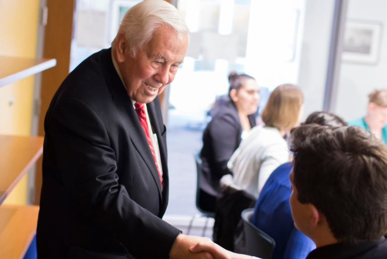 Richard Lugar shakes a student's hand