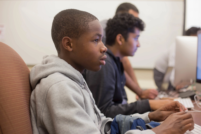 Students work on projects on a computer