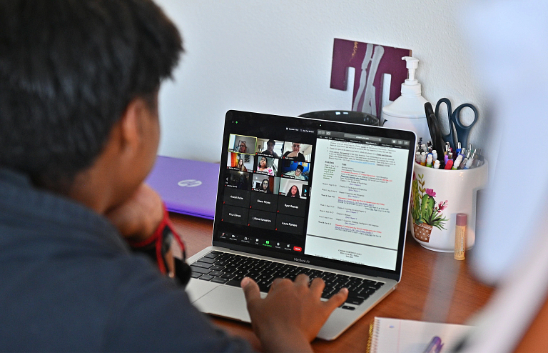 A student participates in a class online