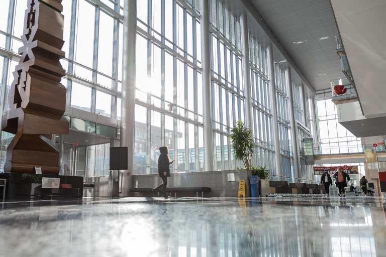 A student walking in the Campus Center