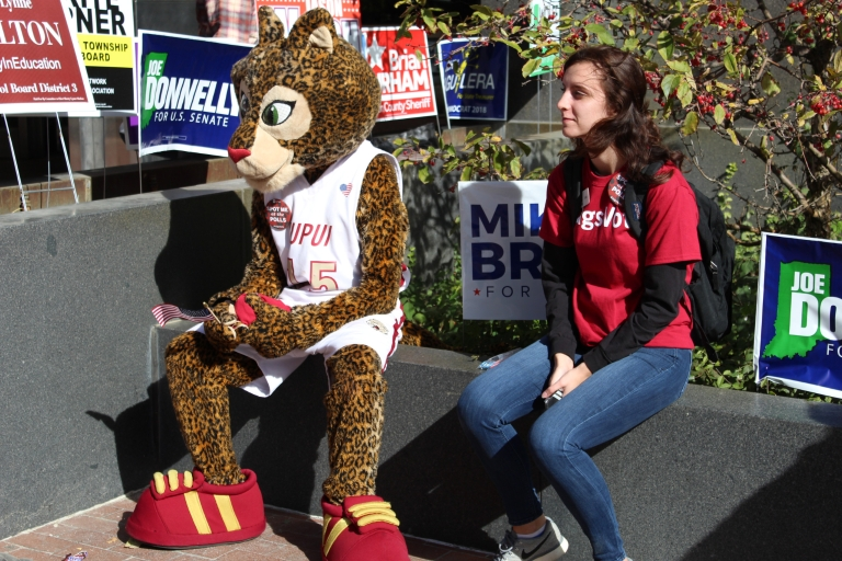 Emily Snooks waits with Jazzy as IUPUI students vote.