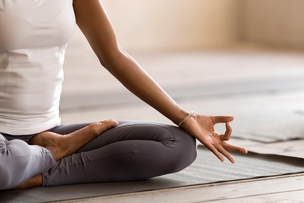 A person participates in a meditation session.