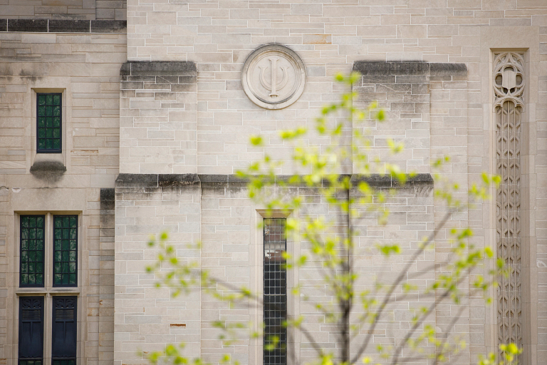 A limestone trident on a building on the IU Bloomington campus