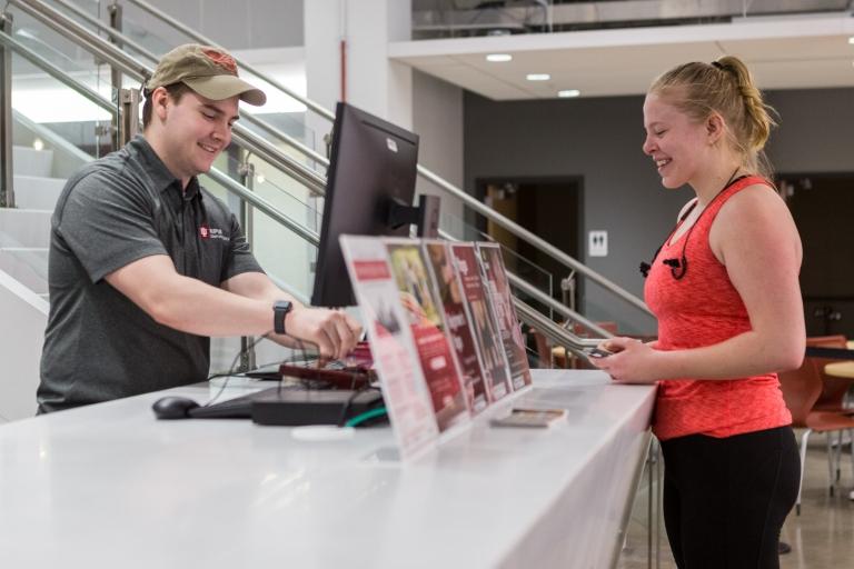 A member checks into the Fitness Center.