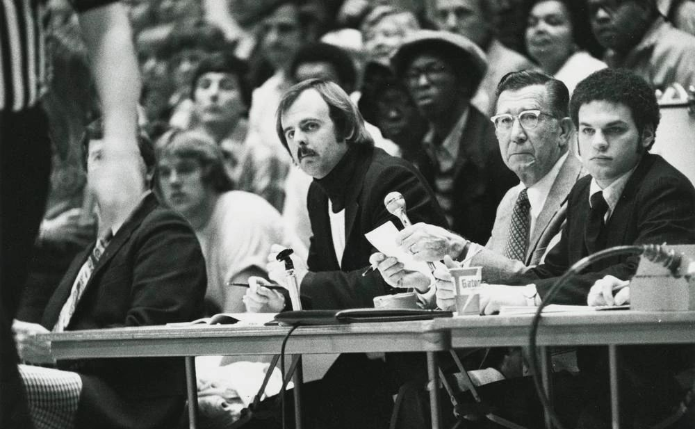 black-and-white archive photo of Chuck Crabb seated a game