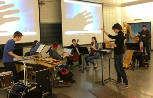 Student musicians rehearse with film